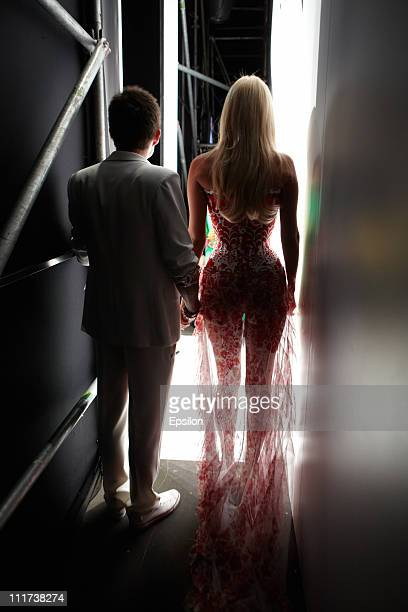 Model Victoria Lopyreva and singer Vlad Topalov wait for the start of the YanaStasia show on day 5 of the Mercedes-Benz Fashion Week Russia...
