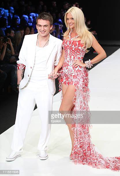 Model Victoria Lopyreva and singer Vlad Topalov wear a creation by designers Yana and Anastasia Shevchenko by YanaStasia on day 5 of the...