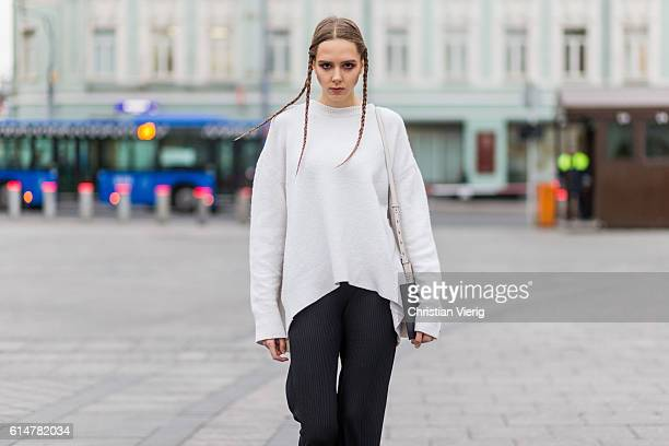 Model Victoria with a white sweater and braid hair on October 14 2016 in Moscow Russia