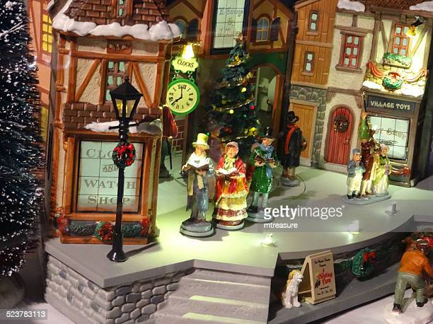 model victorian 'dickens' christmas village with miniature houses, people, winter-scene - ebenezer scrooge stock photos and pictures