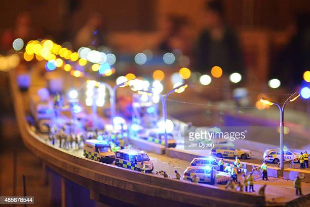 A model village by artist Jimmy Cauty depicts a miniature Police State called 'Aftermath Displacement Principle' as Banksy's Dismaland Bemusement...