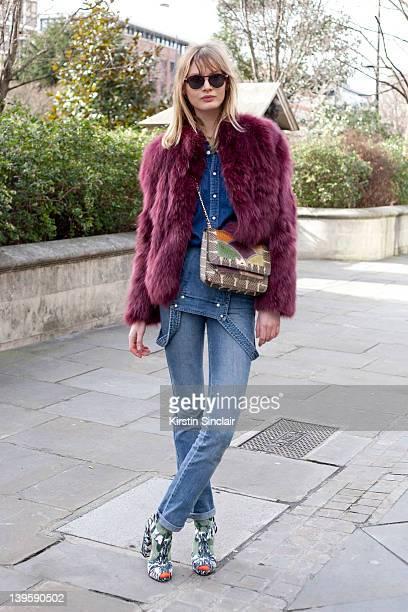 Model Vistoria Sekrier wearing Kat Maconey shoes Vintage Levi jeans vintage shirt and jacket Angela Jackson bag Hugo Boss sunglasses street style at...