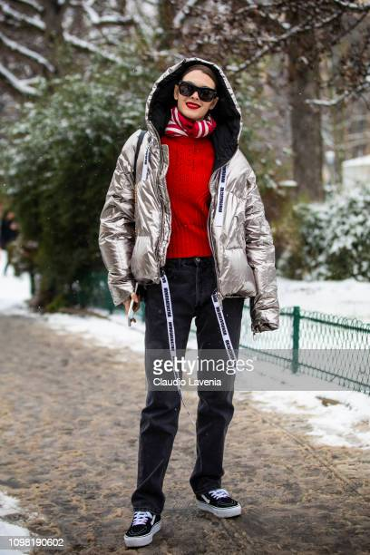 Model Vittoria Ceretti wearing a silver bomber jacket black jeans and black Vans is seen outside Chanel show during Paris Fashion Week Haute Couture...