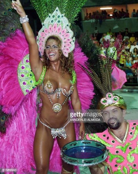 Model Viviane Araujo dances with a member of the Mangueira samba school perform 27 February 2001 during the final night of Rio de Janeiro's Samba...
