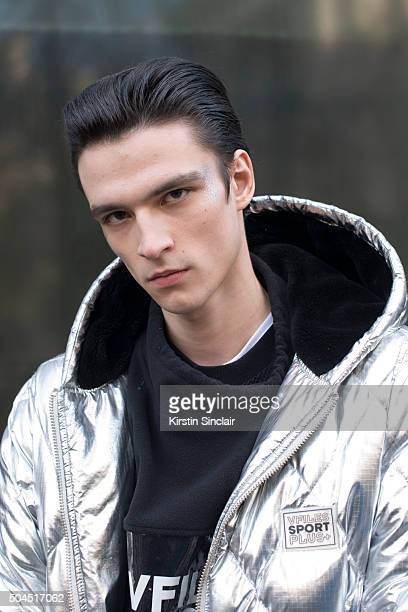 Model Vlad B wears a Vfiles coat WIA tracksuit and vest on day 3 of London Collections Men on Januay 10 2016 in London England