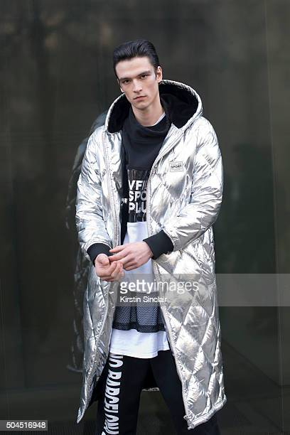 Model Vlad B wears a Vfiles coat WIA tracksuit trousers and vest on day 3 of London Collections Men on Januay 10 2016 in London England