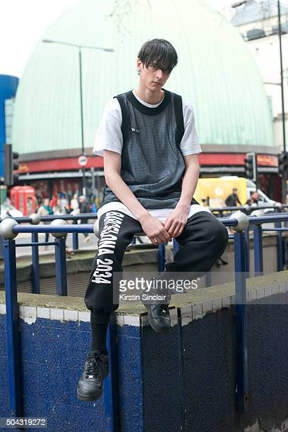 Model Vlad B wears a WIA vest and track suit trousers and Nike trainers on day 2 of London Collections Men on Januay 9 2016 in London England