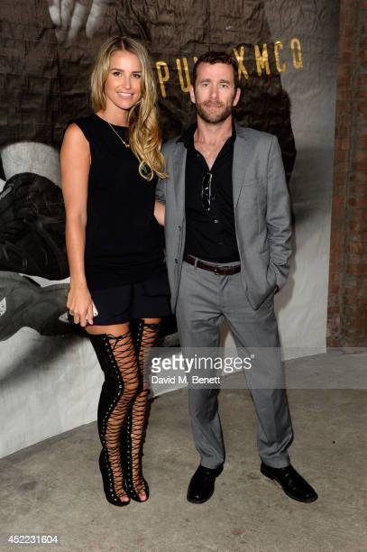Model Vogue Williams and guest attend the PUMA x McQ debut AW14 collection launch at Factory 7 on July 16 2014 in London England