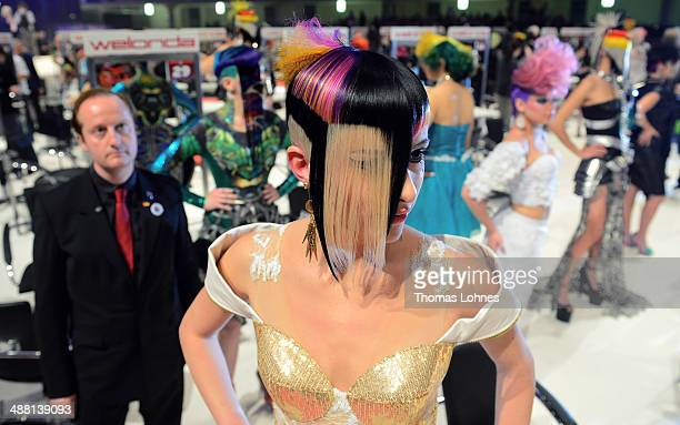 A model waits after the contest 'Full Fashion Look' for the rating of the jury during the OMC Hairworld World Cup on May 4 2014 in Frankfurt am Main...