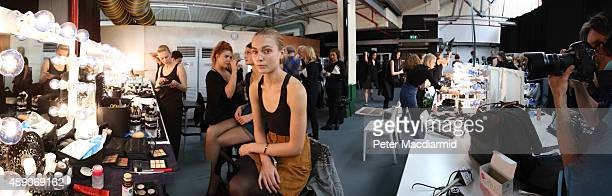 A model waits backstage ahead of the JeanPierre fashion show during London Fashion Week Spring/Summer 2016/17 on September 18 2015 in London England