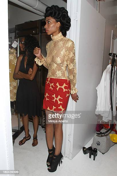 Model waits backstage at the St Wobil fashion show during MercedesBenz Fashion Week Spring 2014 at The Designer's Loft at Studio 450 on September 12...