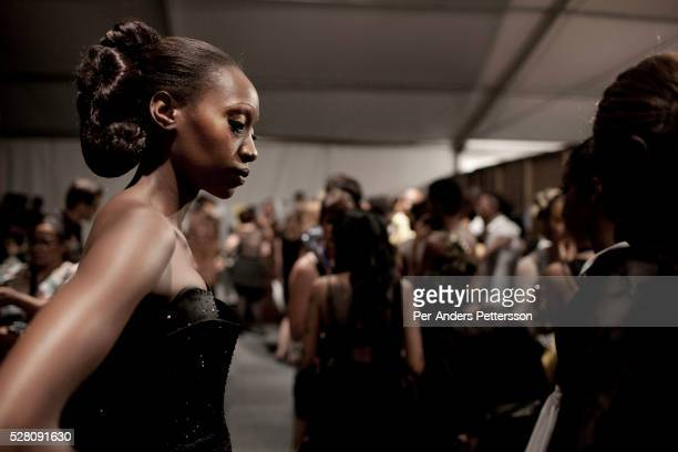 A model waits backstage before a show for the designer label David Tlale at the Joburg Fashion Week on March 09 2012 at the Hyde Park Mall in...