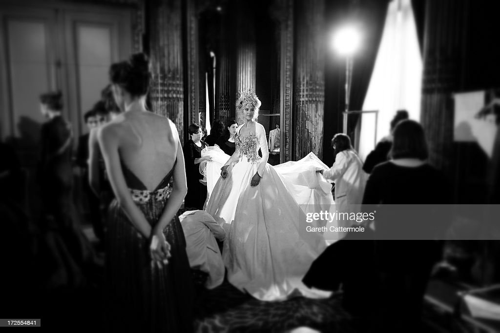 A model waits backstage before the Tony Yaacoub show as part of Paris Fashion Week Haute-Couture Fall/Winter 2013-2014 at Hotel Westin on July 2, 2013 in Paris, France.