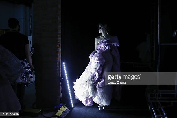 A model waits backstage during the JUSERE show in the MercedesBenz China Fashion Week Autumn/Winter 2016/2017 at 751DPARK on March 30 2016 in Beijing...