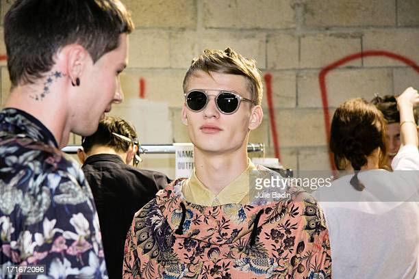 A model waits backstage for the Dries Van Noten Menswear Spring/Summer 2014 Show As Part Of The Paris Fashion Week on June 27 2013 in Paris France