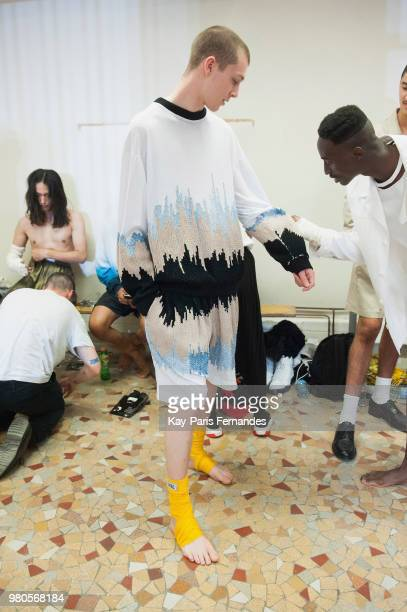 A model waits backstage prior the Louis Gabriel Nouchi Menswear Spring Summer 2019 show as part of Paris Fashion Week on June 21 2018 in Paris France