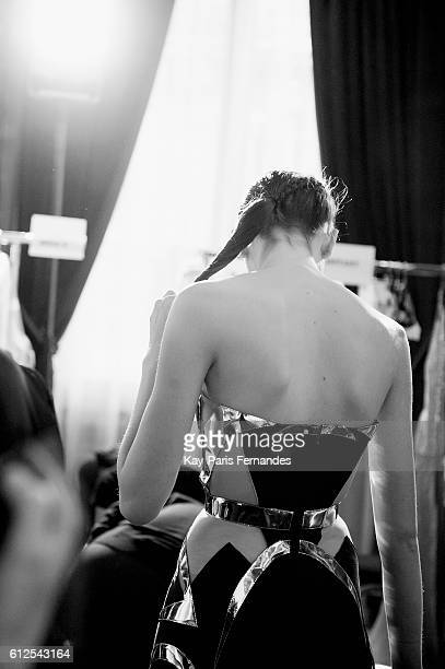 Model waits backstage prior to the Valentin Yudashkin show as part of the Paris Fashion Week Womenswear Spring/Summer 2017 on October 4, 2016 in...