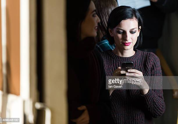 Model waits prior the Cedric Charlier show as part of the Paris Fashion Week Womenswear Spring/Summer 2015 on September 24 2014 in Paris France