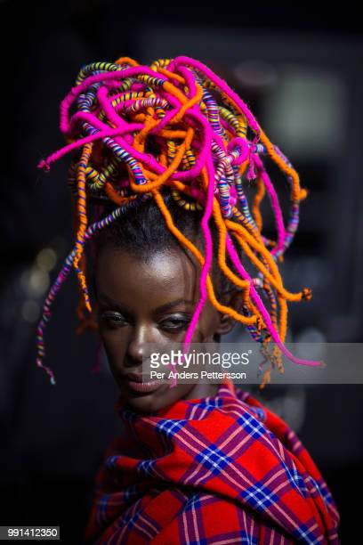 A model waits to have her makeup done before a show on August 17 2017 in Mall of Africa north of Johannesburg South Africa AFI Mercedes Benz Joburg...