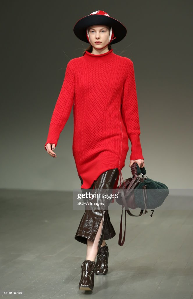 A model walk the runway at the Eudon Choi Show during London Fashion Week February 2018 at BFC Show Space.