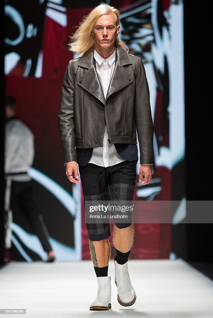 A model walk the runway at the Whyred show at Fashion Week in Stockholm SS 15 on August 27, 2014 in Stockholm, Sweden.