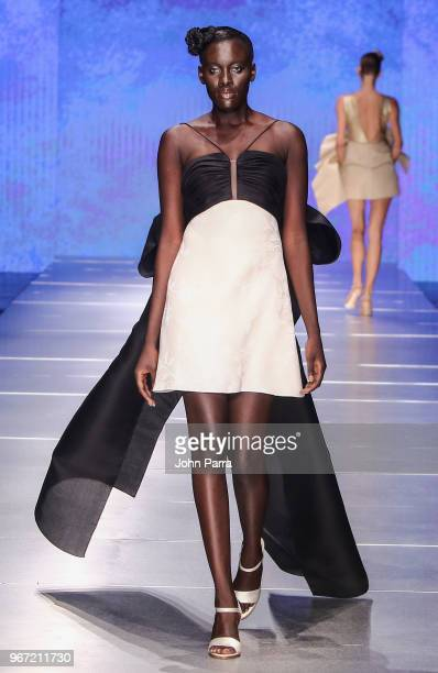 A model walk the runway during Miami Fashion Week 2018 Angel Sanchez Runway at Ice Palace on June 3 2018 in Miami Florida