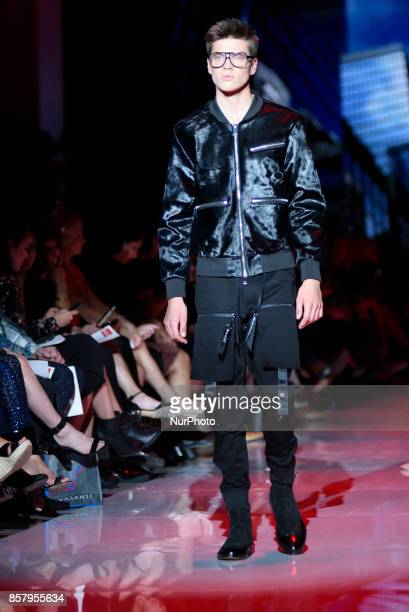 A model walking the runway during CANADA 150 Fashion show on day three of Toronto Women's Fashion Week in Toronto Canada on 4 October 2017
