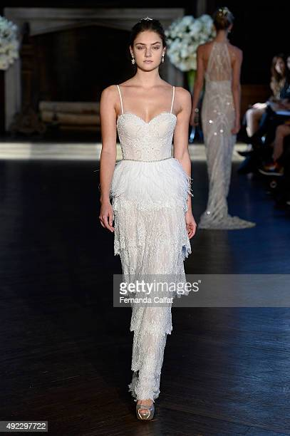 Model walks at Alon Livne White Bridal Fall/Winter 2016 Runway Show at The High Line Hotel on October 11, 2015 in New York City.