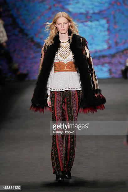 A model walks at the Anna Sui Runway Show during MercedesBenz Fashion Week Fall 2015 at The Theatre at Lincoln Center on February 18 2015 in the...