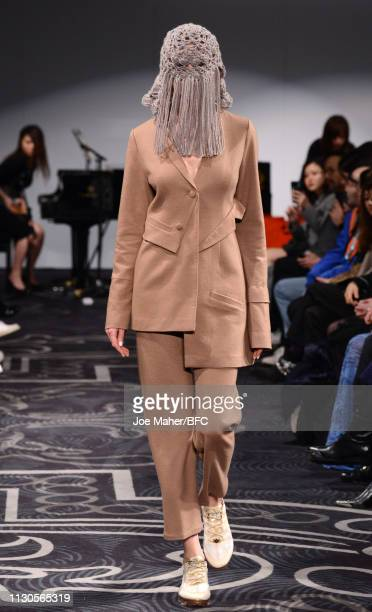 Model walks at the APUJAN Autumn/Winter 2019 event during London Fashion Week February 2019 at the 8 Northumberland Avenue on February 18, 2019 in...