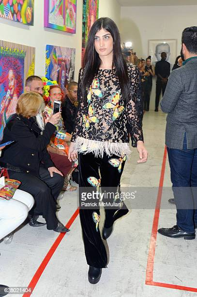 Model walks at the Patricia Field Art Basel Debut with Art Fashion Pop Up and Runway Presentation at The White Dot Gallery in Wynwood on December 1...