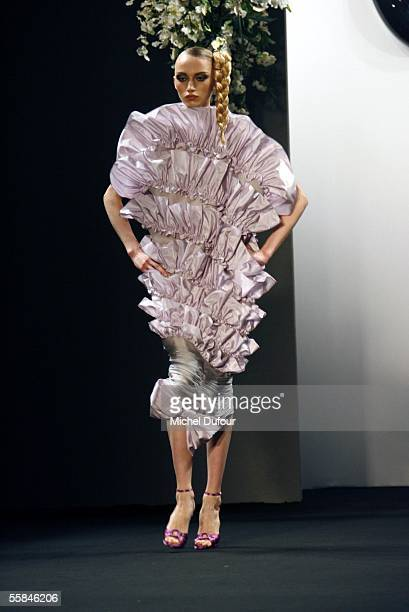 Model walks down the catwalk at the Viktor Rolf show as part of Paris Fashion Week Spring/Summer 2006 on October 3 2005 in Paris France