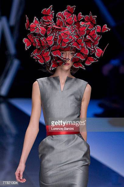 Model walks down the catwalk during the Alexander McQueen ready to wear Spring Summer 2008 show at Paris Fashion Week 2007 on October 5, 2007 in...