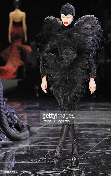 A model walks down the catwalk during the Alexander McQueen ReadytoWear A/W 2009 fashion show during Paris Fashion Week at POPB on March 10 2009 in...