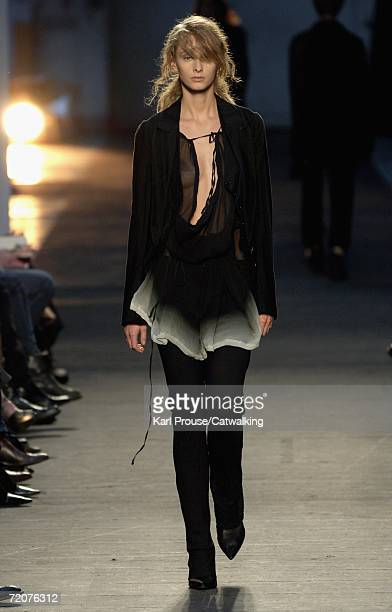 Model walks down the catwalk during the Ann Demeulemeester Fashion Show as part of Paris Fashion Week Spring/Summer 2007 on October 3, 2006 in Paris,...