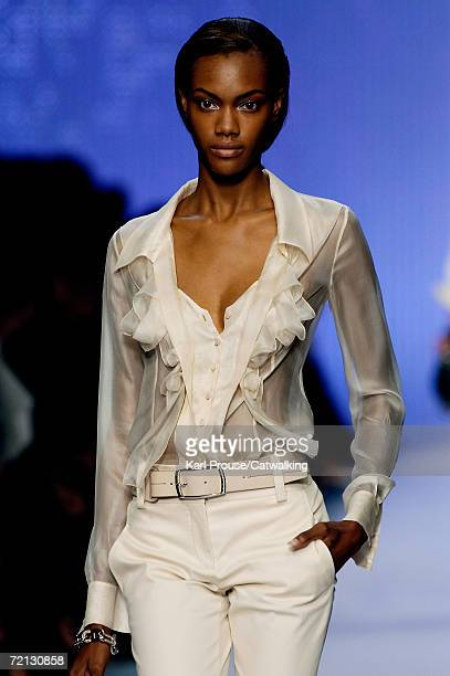 A model walks down the catwalk during the Celine Fashion Show as part of Paris Fashion Week Spring/Summer 2007 on October 5 2006 in Paris France