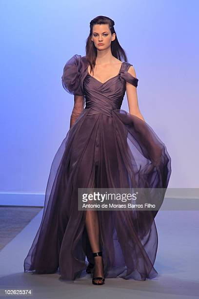 A model walks down the catwalk during the Christophe Josse show as part of the Paris Haute Couture Fashion Week Fall/Winter 2011 at Palais De Tokyo...