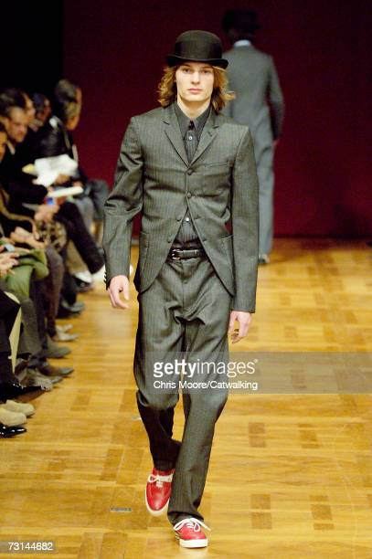 A model walks down the catwalk during the Comme Des Garcons Homme Plus fashion show as part of Paris Menswear Autumn/Winter 2007 on January 27 2007...