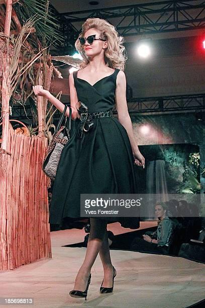 A model walks down the catwalk during the Dsquared2 fashion show at Hotel International Tashkent on October 23 2013 in Tashkent Uzbekistan