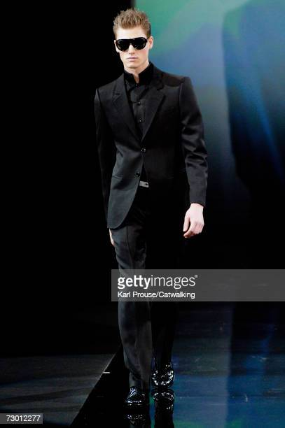 Model walks down the catwalk during the Emporio Armani fashion show as part of Milan Fashion Week Autumn/Winter 2007 on January 14, 2007 in Milan,...