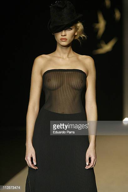 A model walks down the catwalk during the Fernando Alvarado show during Fall/Winter 20082009 Cibeles Fashion Week at the IFEMA on February 14 2008 in...