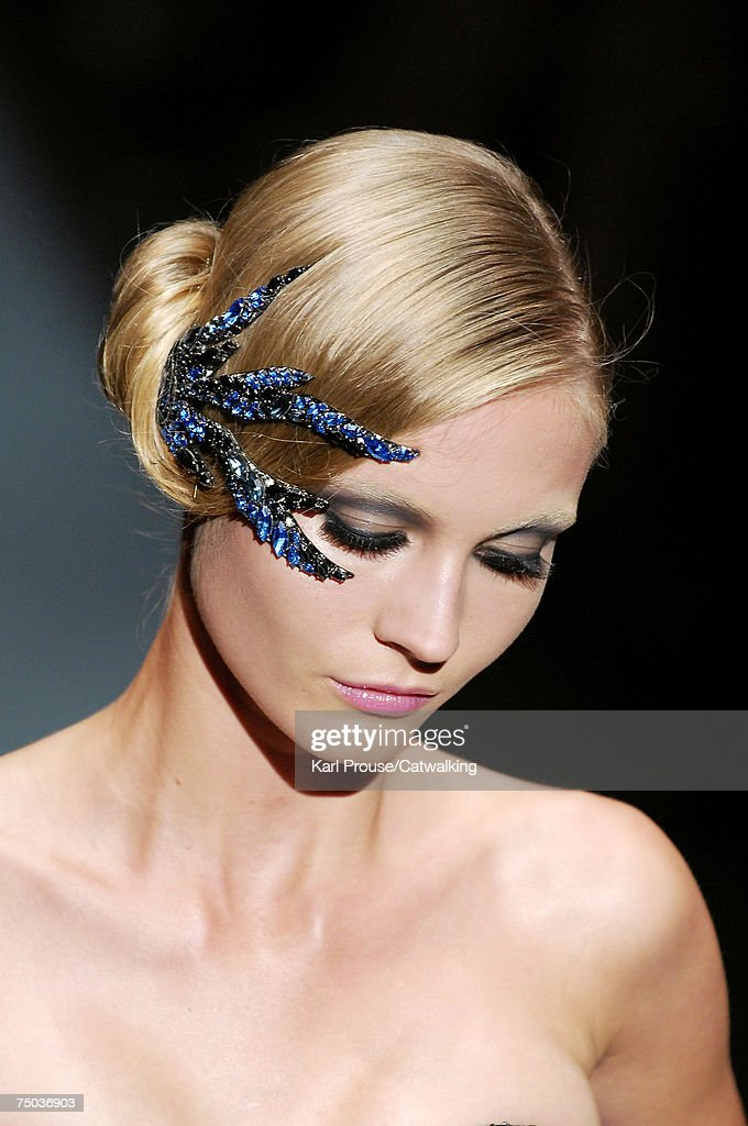 A model walks down the catwalk during the Giorgio Armani Prive fashion show, as part of the Paris Haute Couture Fashion Week Autumn/Winter 2007 - 08 on July 4, 2007 in Paris, France.