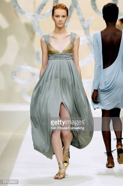 A model walks down the catwalk during the Guy Laroche Fashion Show as part of Paris Fashion Week Spring/Summer 2007 on October 7 2006 in Paris France