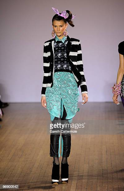 A model walks down the catwalk during the House of Holland fashion show during London Fashion Week on February 20 2010 in London England