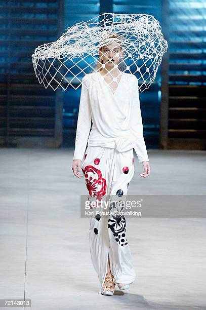 A model walks down the catwalk during the John Galliano Fashion Show as part of Paris Fashion Week Spring/Summer 2007 on October 7 2006 in Paris...