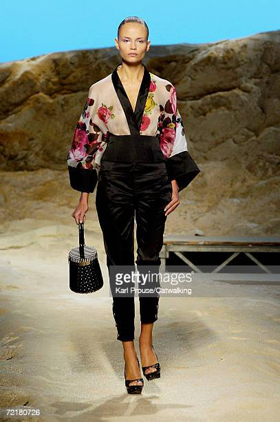 A model walks down the catwalk during the Kenzo Fashion Show as part of Paris Fashion Week Spring/Summer 2007 on October 7 2006 in Paris France