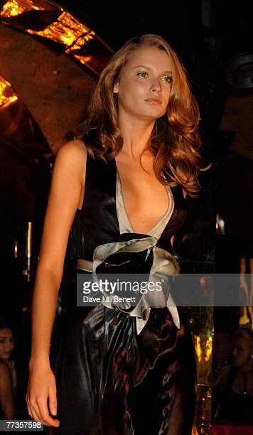 A model walks down the catwalk during the launch of Kate Moss's new Top Shop 'Christmas Range' collection at Annabel's October 16 2007 in London...