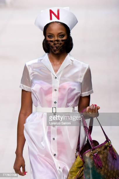 Model walks down the catwalk during the Louis Vuitton Spring Summer 2008 show at Paris Fashion Week 2007 on October 6 2007 in Paris France