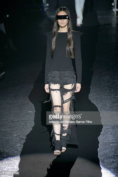 Model walks down the catwalk during the Maison Martin Margiela Pret-a-Porter show as part of Paris Fashion Week Spring/Summer 2008 on October 1, 2007...