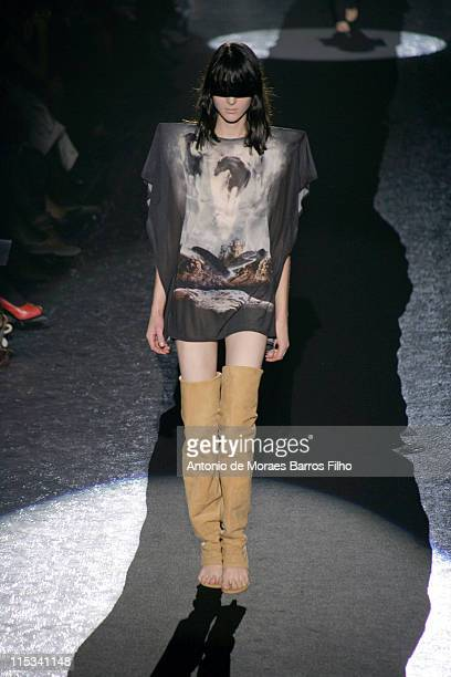 A Model walks down the catwalk during the Maison Martin Margiela PretaPorter show as part of Paris Fashion Week Spring/Summer 2008 on October 1 2007...
